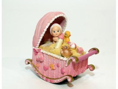 Muzikinė dekoracija - lovytė su kūdikiu